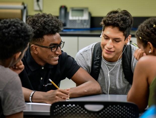 Annandale High students confer over an ...