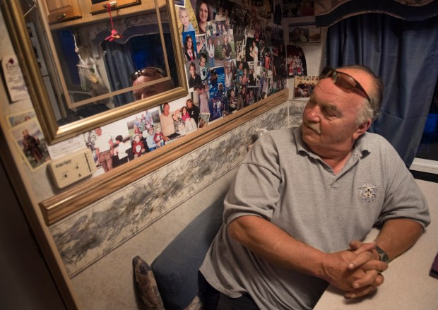 Photos of Mark and Joanne Molnar's children and grandchildren adorn a wall in the couple's camper in Trenton, Maine.