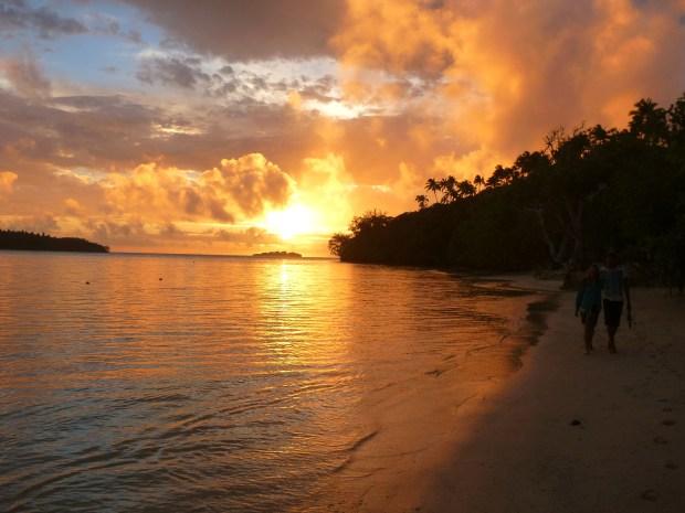 A sunset walk along Ofu island beach.