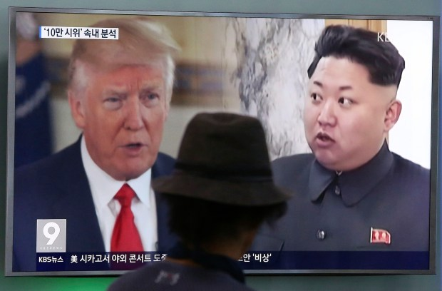 A man at a train station in Seoul, South Korea, watches a TV screen showing President Donald Trump and North Korean leader Kim Jong-un on Aug. 10.