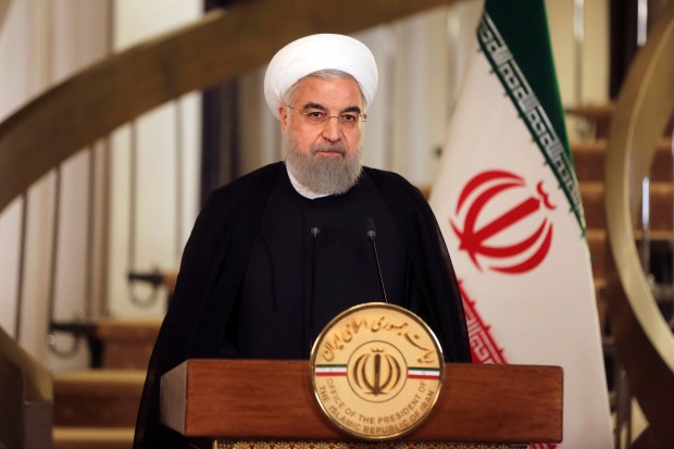 In this photo released by official website of the office of the Iranian Presidency, President Hassan Rouhani addresses the nation in a televised speech last Friday. Rouhani spoke after President Donald Trump angrily accused Iran of violating the spirit of the 2015 accord and demanded Congress toughen the law governing U.S. participation.