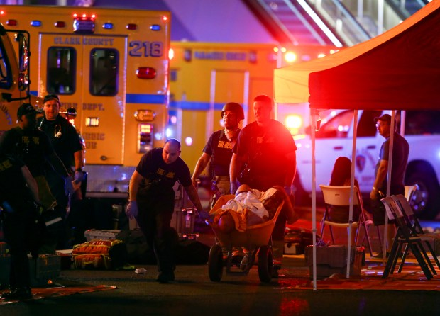 A wounded person is transported in a wheelbarrow after Sunday night's massacre at a music festival in Las Vegas.
