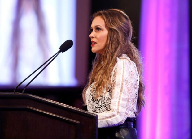 """Actress Alyssa Milano speaks at the 2017 World Of Children Hero Awards at Montage Beverly Hills on April 19 in Beverly Hills, Calif. Milano took to Twitter on Sunday and urged any women who have been sexually harassed or assaulted to write two words on Twitter: """"Me too."""" The response was massive."""