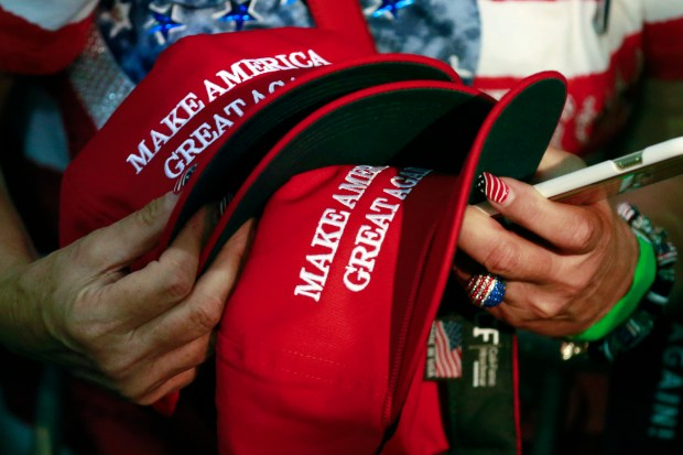 A woman holds hats during a rally for Republican presidential candidate Donald Trump during a June 2, 2016, rally in San Jose, Calif.