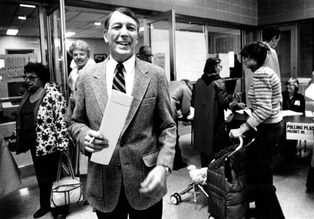 Congressional candidate Jack Swigert casts his vote with a smile in Nov. 1982.