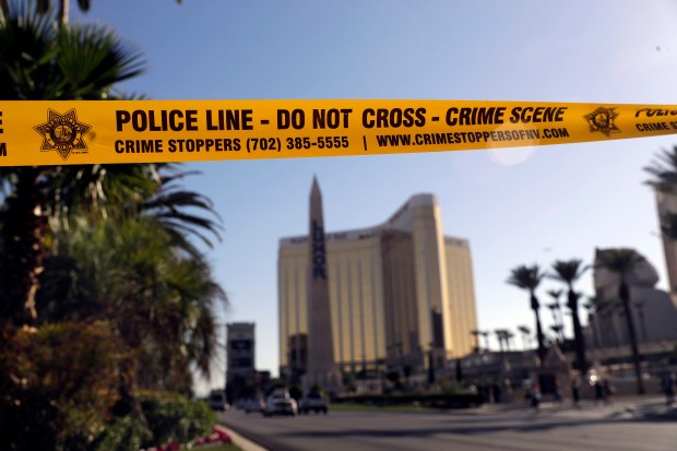 Police tape blocks Reno Avenue in Las Vegas on Wednesday, following Sunday's mass shooting at an outdoor music concert.