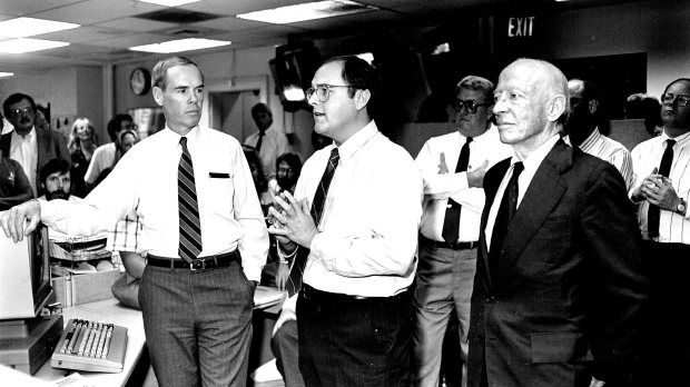 William Dean Singleton, center, of MediaNews Group, speaks to staff of Denver Post newsroom on Sept. 15, 1987, after announcement of sale of the Post to MediaNews Group. At left is then-Post publisher Richard Schlosberg. At right is Singleton's partner Richard B. Scudder, chairman of the board of MNG.