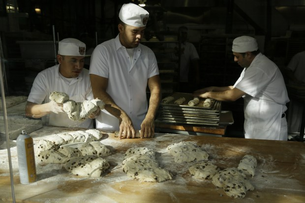 Bakers make sourdough bread at the Boudin Bakery at Fisherman's Wharf in San Francisco. The Bay Area has a long history of making sourdough bread, with Boudin Bakery even using mother dough that can be traced back to the Gold Rush.