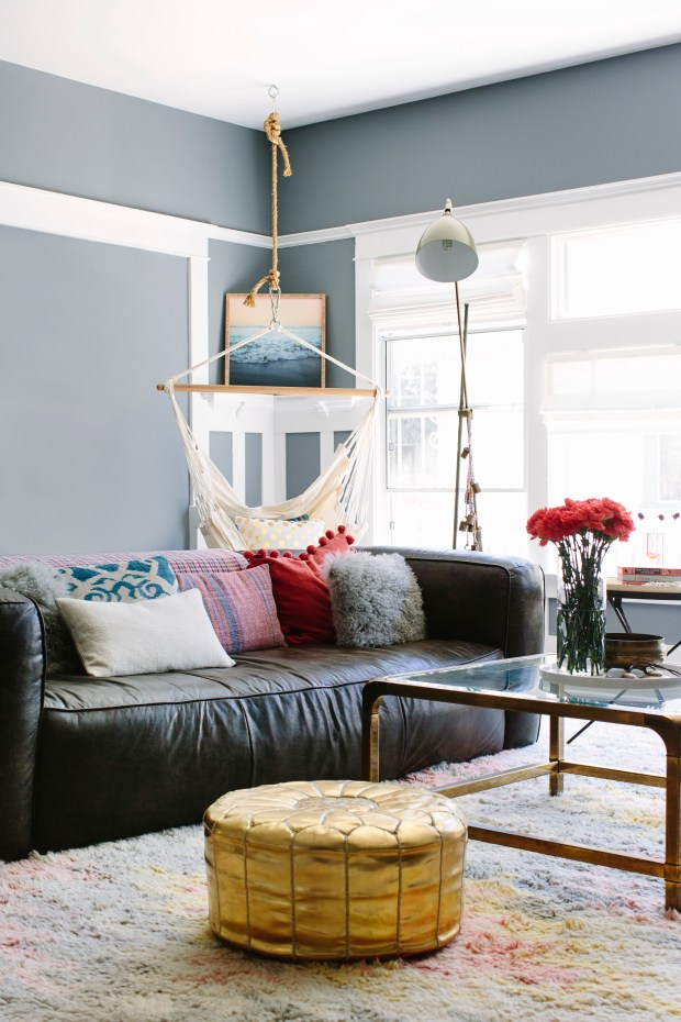 A living room designed by Caitlin Murray, founder of Black Lacquer Design in Los Angeles. The room includes a sleek brass coffee table. When Murray searches for striking vintage pieces at flea markets or estate sales, she always looks for valuable brass pieces being sold well below their market value.
