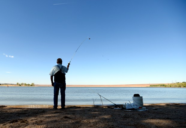 A fisherman at Chatfield Reservoir on Sept. 18.