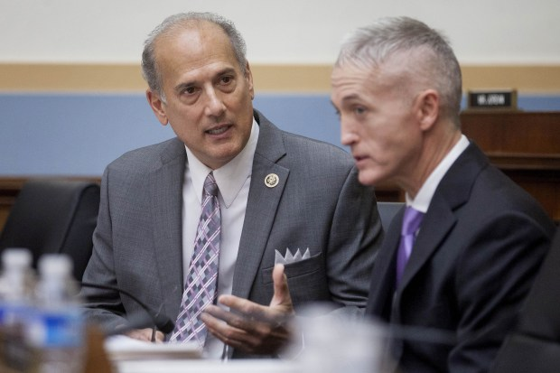 U.S. Rep. Tom Marino, R-Pa., left, ...