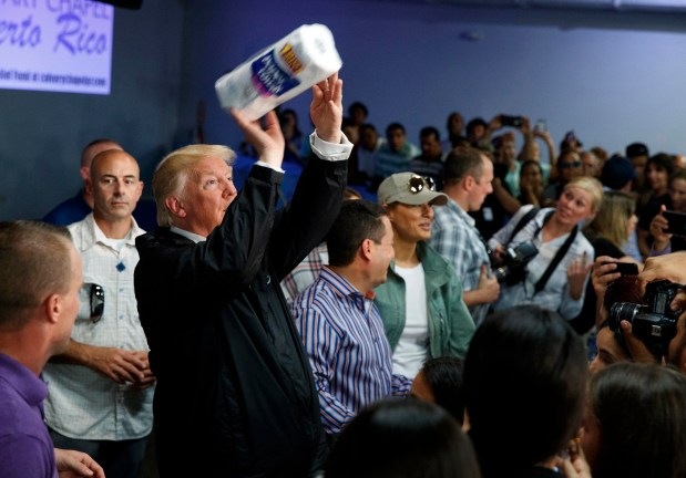 President Donald Trump tosses paper towels into a crowd at Calvary Chapel in Guaynabo, Puerto Rico, last Tuesday.