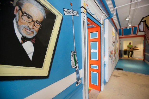 A mural that features Theodor Seuss Geisel, also know by his pen name Dr. Seuss, rests on a wall near an entrance at The Amazing World of Dr. Seuss Museum in Springfield, Mass., on May 4. The new museum devoted to Dr. Seuss opened on June 3 in his hometown.