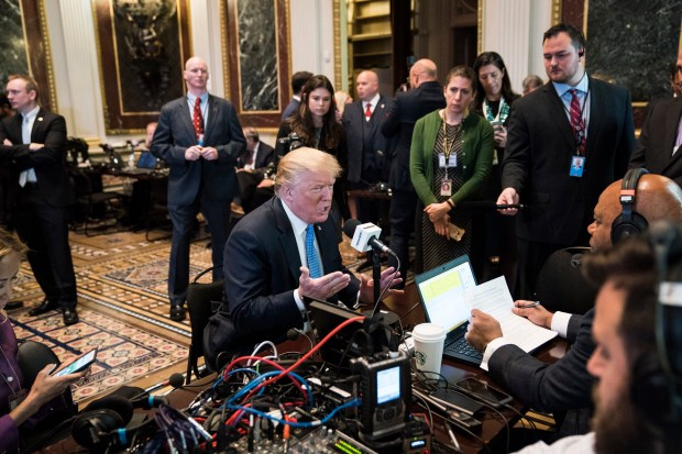 President Donald Trump sits for a ...