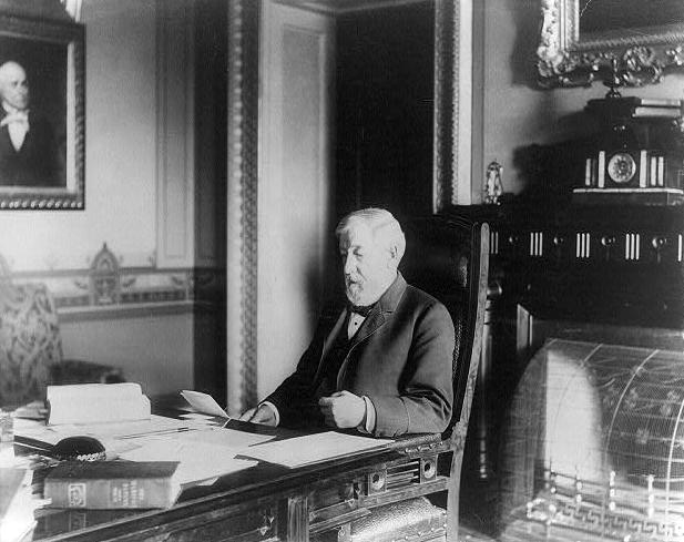 """U.S. Secretary of State James Blaine sits in his office in 1890. As a congressman, Blaine in 1875 sponsored an amendment that would require free public schools for all children and barred the use of """"any school funds or school taxes for the benefit or aid to any religious sect or denomination."""""""
