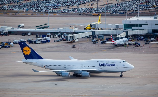 A Lufthansa 747-400 taxis at Denver in 2016.