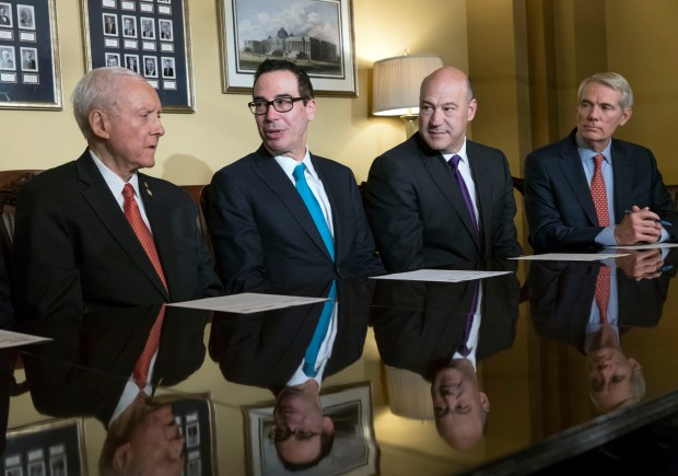 Senate Finance Committee Chairman Orrin Hatch, Treasury Secretary Steven Mnuchin, White House economic adviser Gary Cohn and Sen. Rob Portman speaks to reporters as work gets underway on the Senate's version of the GOP tax reform bill on Nov. 9 in Washington.