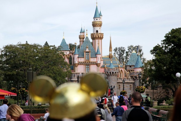 Visitors walk toward Sleeping Beauty's Castle at Disneylandin Anaheim, Calif., on Jan. 22, 2015.