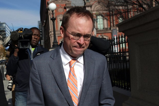 White House Budget Director Mick Mulvaney, President Donald Trump's pick for acting director of the Consumer Financial Protection Bureau, walks back to the White House from the CFPB building after he showed up for his first day of work on Monday in Washington.