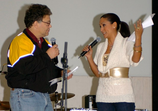 In this image provided by the U.S. Army, then-comedian Al Franken and sports commentator Leeann Tweeden perform a comic skit at Forward Operating Base Marez in Mosul, Iraq, on Dec. 16, 2006, during a USO tour. Franken, now a U.S. senator, apologized on Nov. 16 after Tweeden accused him of forcibly kissing her during the tour.