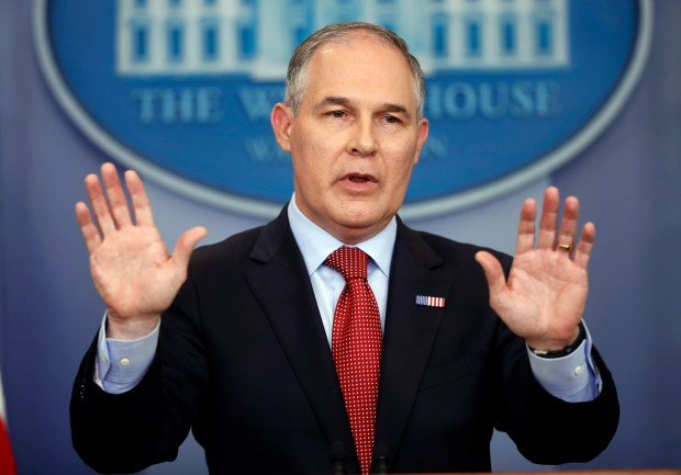 EPA Administrator Scott Pruitt gestures as he speaks to the media at the White House on June 2.