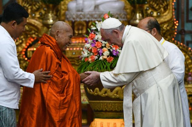 Pope Francis attends a meeting with Bhaddanta Kumarabhivasma, chairman of state Sanga Maha Nayaka Committee, in Yangon, Myanmar, on Wednesday.