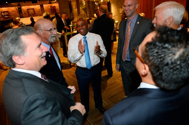 Denver Mayor Michael Hancock meets with new members of the City Council prior to taking the oath of office at the inauguration ceremony for his second term in the Ellie Caulkins Opera House on July 20, 2015. From left are Kevin Flynn, Paul Kashmann, Jolon Clark, Rafael Espinoza and City Auditor Tim O'Brien.