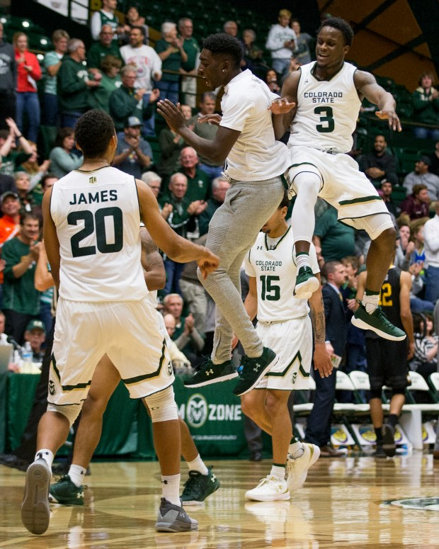 Colorado State guard Raquan Mitchell (3) celebrates a slam dunk against Winthrop with teammate Kris Martin during a timeout Tuesday evening Nov., 14, 2017, at Moby Arena in Fort Collins. Colorado State won the game, 80-76. (Michael Brian/For the Reporter-Herald)