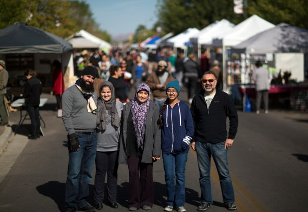 From left to right: Mustafa Azimi, wife Zarifa Azizi, Sureyya Hussain, Reema Iqbal and Radwan Jallad stand for a photo during the downtown farmers market in Las Cruces, N.M.
