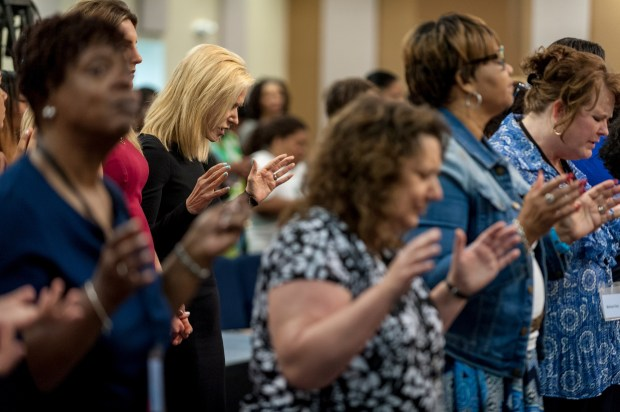 Paula White prays with the congregation at Hope Christian Church in Beltsville, Maryland.