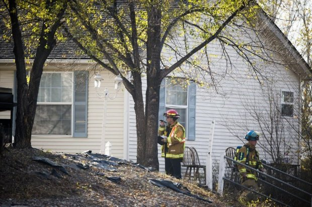 Firefighters walk up and down stairs to an area of the 700 block of East Cucharras St. where a fire broke out on Friday, Nov. 10, 2017. An adult and a 6-year-old were killed in the fire and a 2-year-old was being airlifted by Flight for Life to Denver.
