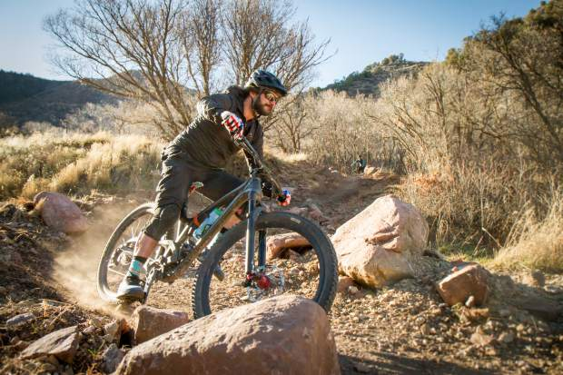 A mountain biker heads down the new Grandstaff Trail on Red Mountain on a beautiful Saturday afternoon. Concerns have been raised about the mix of bikers and hikers on the criss-crossing trails that now exist in the mountain park area on the west flank of Glenwood Springs.