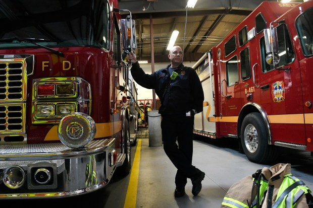 Sable Altura Fire department Battalion Chief Dan Gordon talks with other firefighters in the bay of the fire department on Nov. 2, 2017 in Aurora.