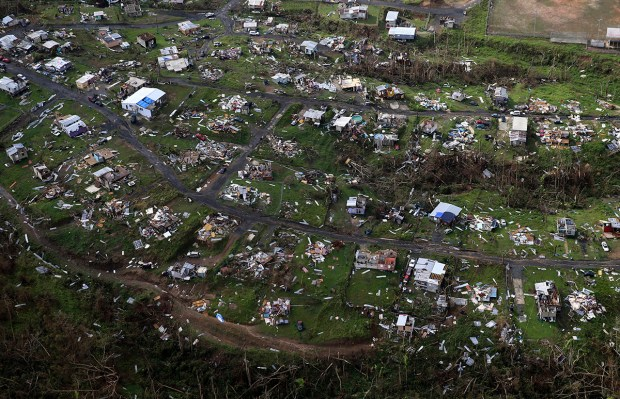 Homes and other buildings destroyed by Hurricane Maria lie in ruins in Toa Alta, Puerto Rico, on Sept. 28.