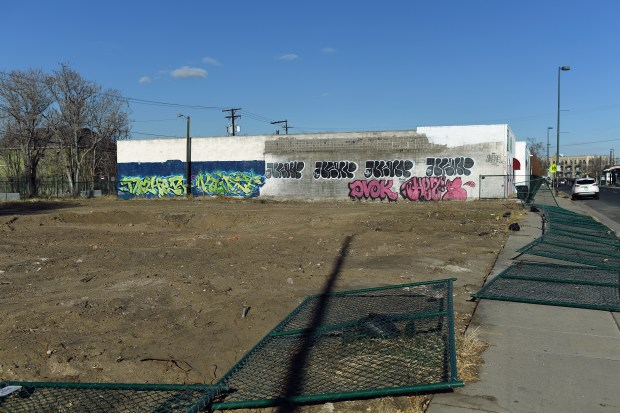 An empty lot, which will soon have new buildings on it, had the surrounding fences knocked over Nov. 28, 2017 in the Five Points neighborhood of Denver.