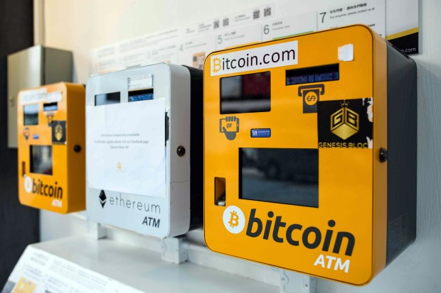 ATM machines for digital currency, including bitcoin, are seen in Hong Kong on Dec. 18.