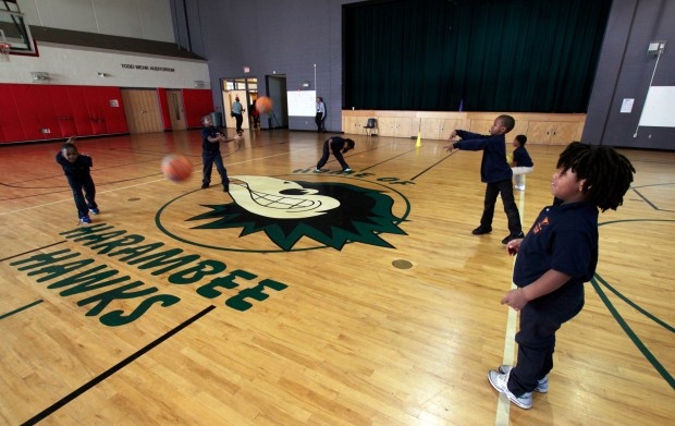 In this Oct. 20, 2017, children take part in gym class at Milwaukee Math and Science Academy, a charter school in Milwaukee. Charter schools are among the nation's most segregated, an Associated Press analysis finds - an outcome at odds, critics say, with their goal of offering a better alternative to failing traditional public schools. Enrollment data shows charters are vastly over-represented among schools where minorities study in the most extreme racial isolation.