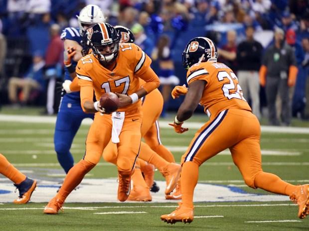 Denver Broncos quarterback Brock Osweiler (17) ...
