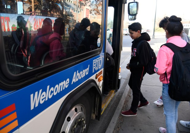 East High School freshman Marcos Cortes, center, enters his second RTD bus, #40, on his way home from school Nov. 14, 2017.