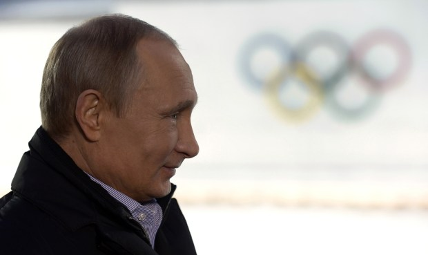 Russian President Vladimir Putin looks on during an interview in Sochi on Jan. 19, 2014, before his country hosted the Winter Olympics. Russia has banned from the 2018 Games for doping.