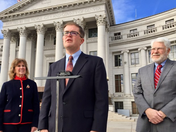 Matt Miller, an attorney for the Phoenix-based Goldwater Institute, discusses a lawsuit filed by the group challenging part of the Denver campaign finance law. With him outside the Denver City and County Building on Dec. 13, 2017, are Marty Neilson, left, of the Colorado Union of Taxpayers, and Penn R. Pfiffner from the TABOR Committee.