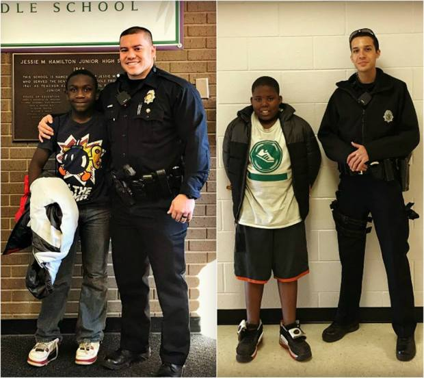 Officers Juan Gamboa and Edward Pacheco Jr. pictured with the students that they had purchased coats for using their own money.