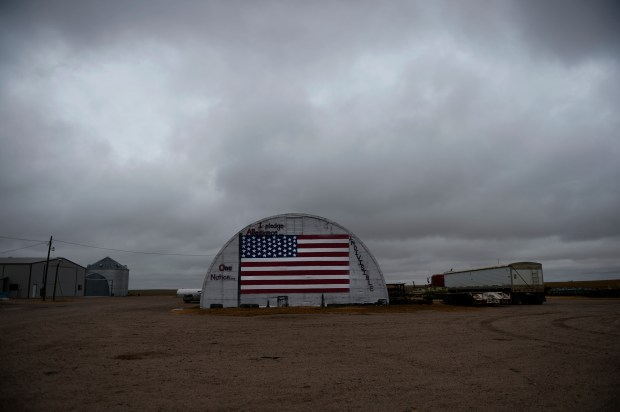 A large American flag is painted on the side of a building at a farm in Kit Carson County, Nov. 05, 2013.