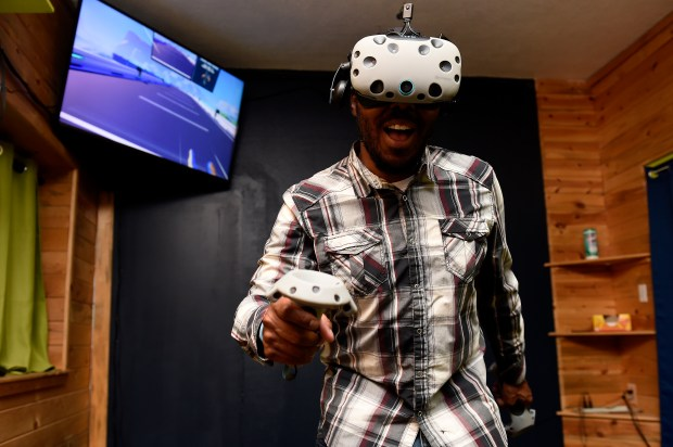Johnathan Carey plays a virtual reality game at Head Games VR, a virtual reality arcade, on Oct. 13 in Lakewood.