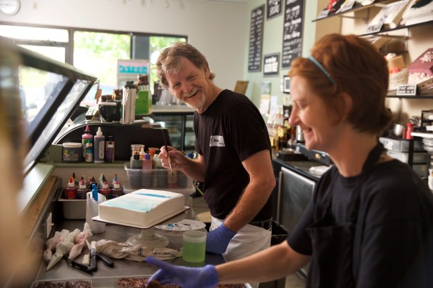 Masterpiece Cakeshop owner Jack Phillips works on a cake at his shop in Lakewood. On Tuesday, the Supreme Court is scheduled to hear a case regarding Phillips' refusal to make a wedding cake for a gay couple in 2012.
