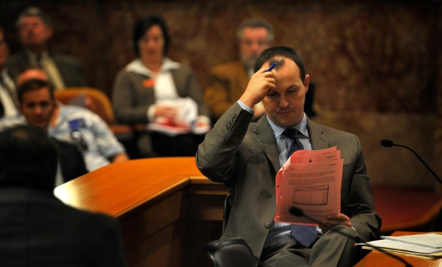 Colorado state Sen. Josh Penry reads over information during a hearing on reforming the Public Employees' Retirement Association pension fund at the Capitol on Jan. 26, 2010. State lawmakers are expected to take another shot at reforming PERA in the upcoming session.