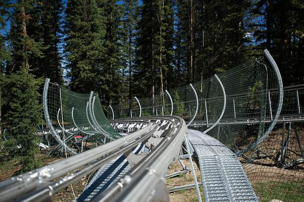 Part of the track for the new alpine coaster going in the Lost Forest at Snowmass. 5,700 feet of track are being installed between the trees on Gunners View and Sandy Park.