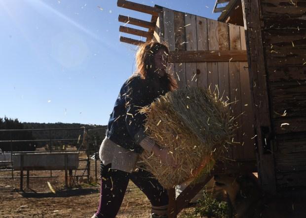 Aubrey Lykins, 27, works on chores ...