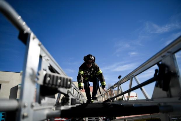 Firefighter Marc Patterson walks across a ...