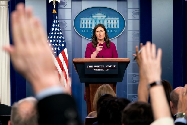 Members of the press raise their hands to ask questions of White House press secretary Sarah Huckabee Sanders on Jan. 29 at the White House.